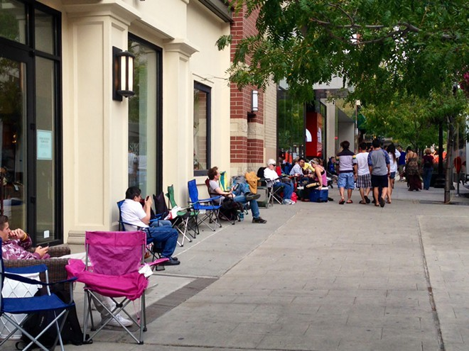 Customers wait in line in downtown Spokane Thursday for the Friday release of the iPhone 6. - HEIDI GROOVER
