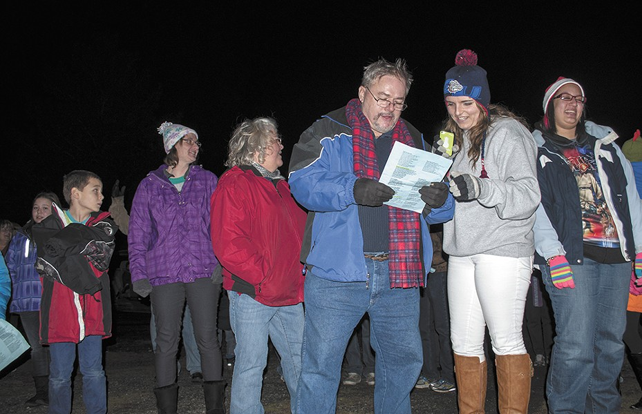 Airway Heights Baptist Church senior pastor Dale Jenkins (left) leads friends and family caroling around nearby neighborhoods. - SARAH WURTZ