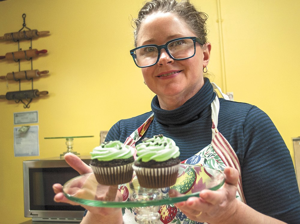 Alberta Bake Shop owner Robie Calcaterra shows off some mint chocolate chip cupcakes. - SARAH WURTZ