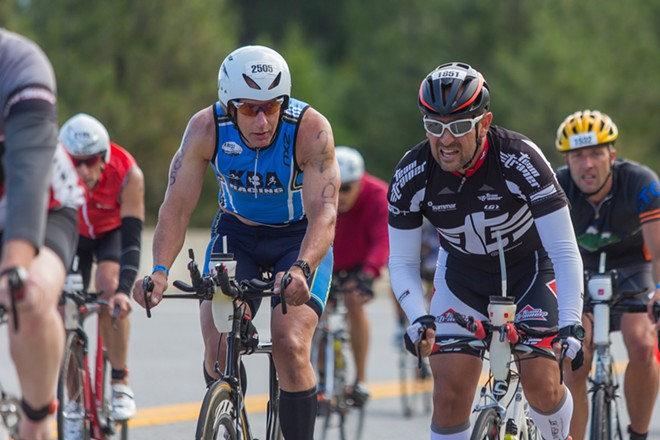 Alvaro Galindo, right, bikes alongside Phillip Kriss. Galindo finished in 13:50:57 and Kriss finished in 12:35:39. - MATT WEIGAND