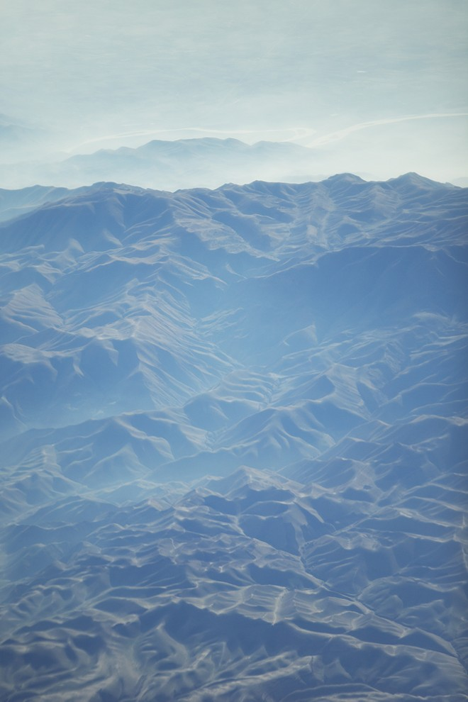 The Hindu Kush Mountains of Afghanistan are photographed from a KC-135. - YOUNG KWAK