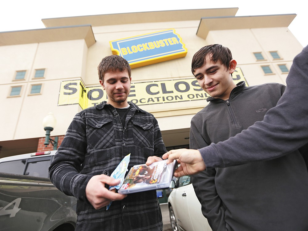 Anthony Schnettler, left, and Giovanni Soto outside of a closing Blockbuster in Cheney. - YOUNG KWAK