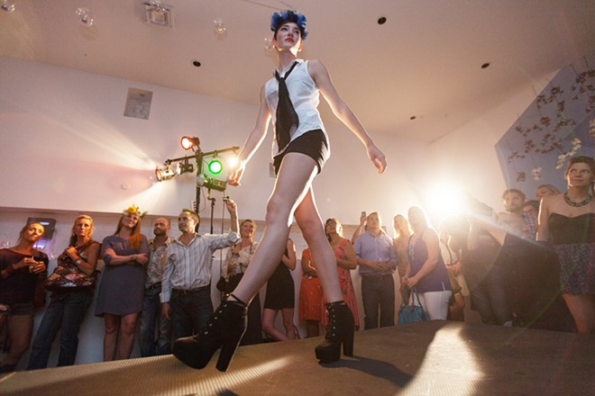 """Ariel St. Clair walks the runway during """"Mademoiselle,"""" produced by Olive + Boone and held at The White Room on Aug. 22. - YOUNG KWAK"""