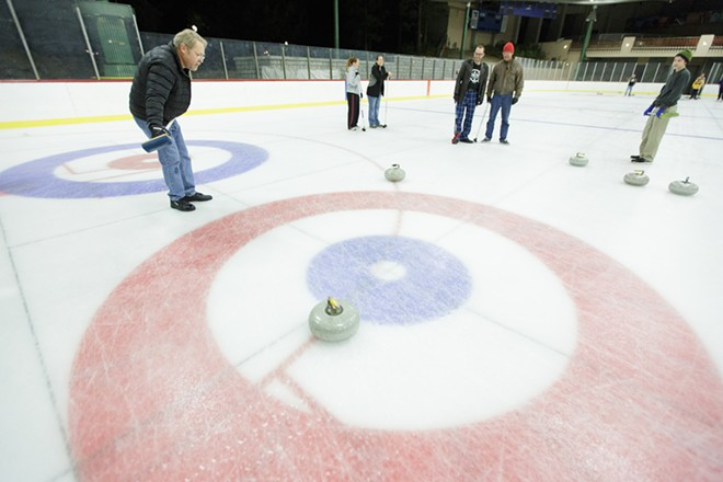 As a skip, Lilac City Curling Club member Robin Gavelin, left, watches a rock approach the house. - YOUNG KWAK