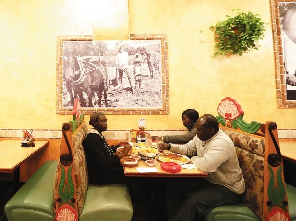 At Azteca Mexican Restaurant, Agwa and his daughter Abang order the Chile Colorado, which they say tastes similar to doro wat — considered the national dish of Ethiopia. - YOUNG KWAK