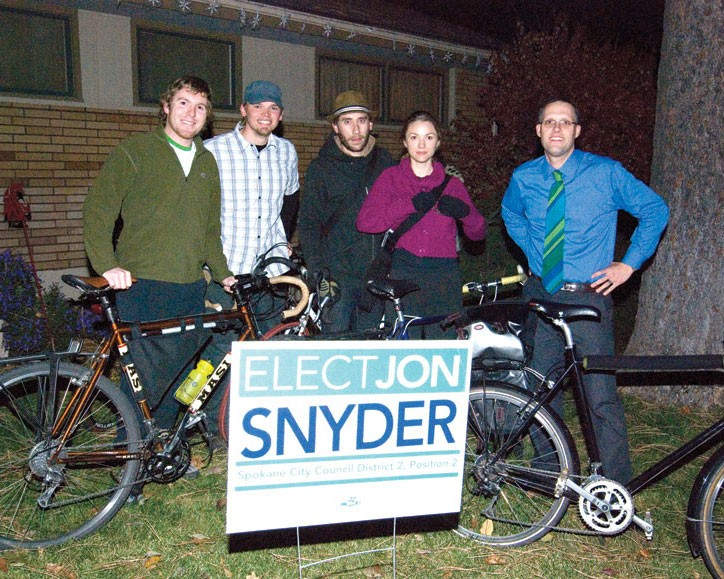 At the victory party for Jon Snyder (right), some revelers kept it real by arriving on two wheels, including (left to right) Bart Mihailovich, Travis Nichols, Patrick Kendrick and Mariah McKay. - TAMMY MARSHALL