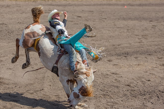 Barely holding on at the Cheney Rodeo. - MATT WEIGAND
