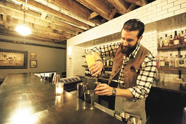 Bartender Ben Fife mixes an Aviation at Durkin's Liquor Bar.| - YOUNG KWAK