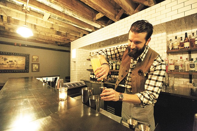 Bartender Ben Fife mixes an Aviation at Durkin's Liquor Bar.| - YOUNG KWAK