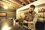 Bartender Ben Fife mixes an Aviation at Durkin's Liquor Bar.|