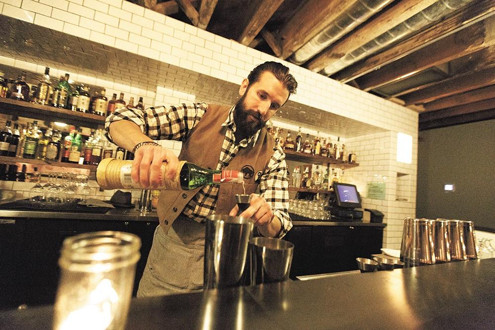 Bartender Ben Fife mixes up an Aviation cocktail. - YOUNG KWAK