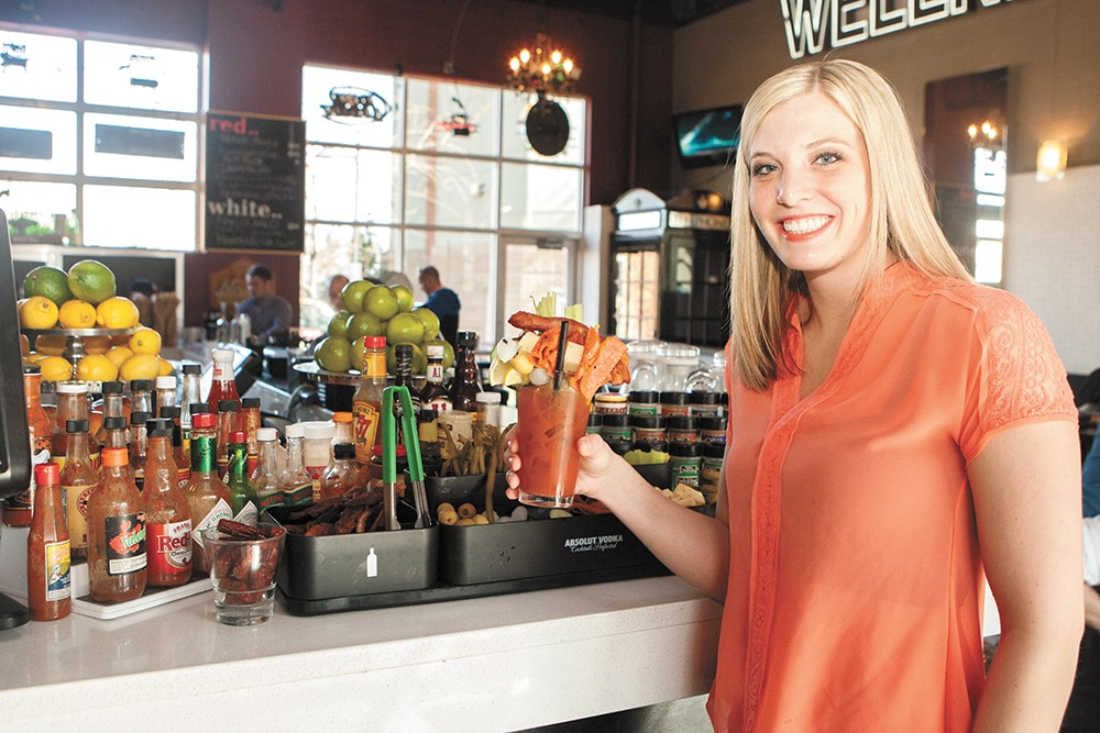 Bartender Gabrielle Daily, with one of Press' beloved Bloody Marys. - MEGHAN KIRK