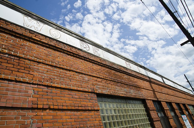 Bazaar will be held outdoors at the old Wonder Bread factory, where signs on the exterior have almost faded away. New location, see update below. - LISA WAANANEN