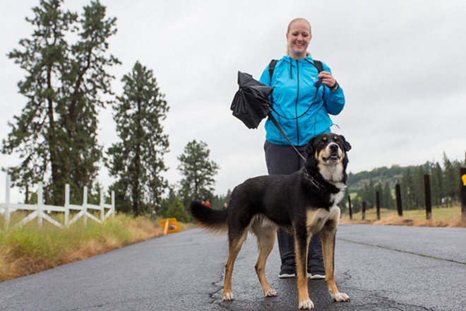 Beau, a 2-year-old mix, walks with his owner Wendy Lingle. - MATT WEIGAND