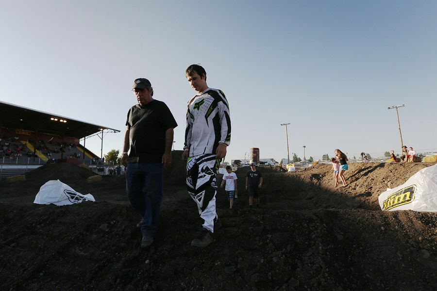 Beginner 250 cc riderMichael Reid, right, and his father Wayne, both from St. Maries, Idaho, walk the course before the 14th Annual Moto X. - YOUNG KWAK