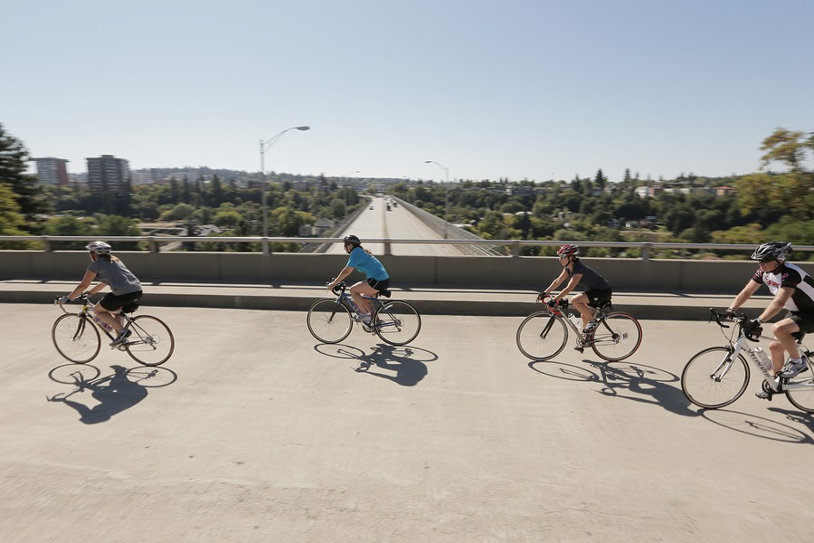 Bicyclists ride the Centennial Trail. - YOUNG KWAK