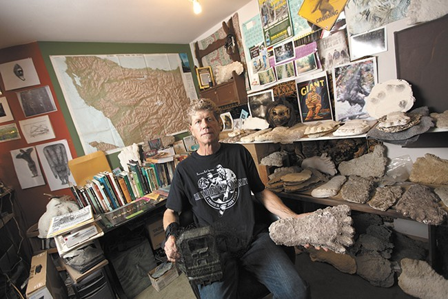 Bigfoot researcher Paul Graves poses with his collection of Sasquatch footprint casts. - YOUNG KWAK