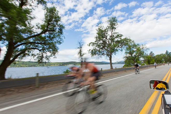 Bikers ride along Lake Coeur d'Alene around Mile 4. - MATT WEIGAND