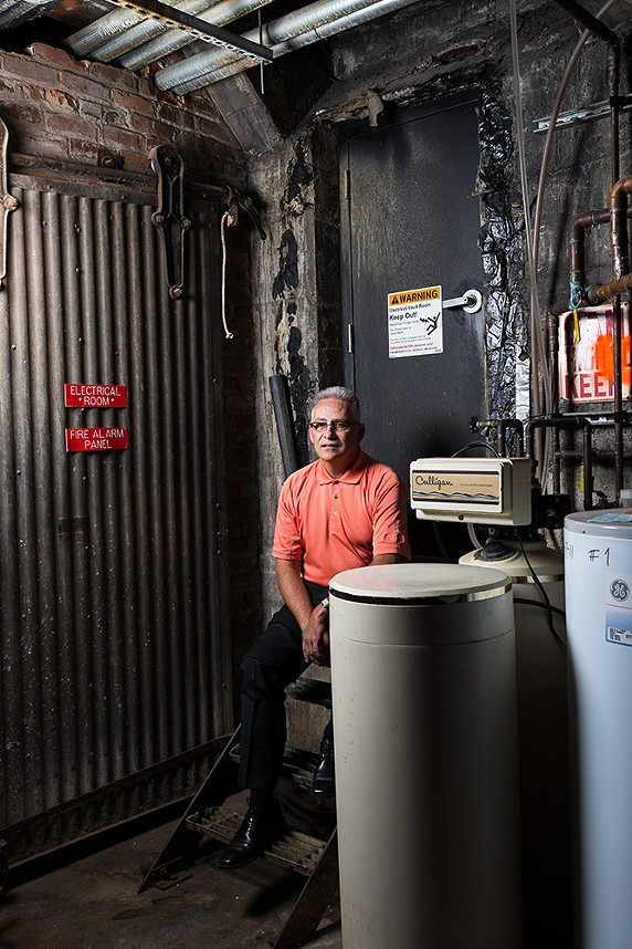 Bill Bancroft in front of the door leading to a tunnel system in downtown Spokane. Although there are smaller self-contained tunnel systems in the city, the tunnels originating from the Steam Plant used to heat downtown and are assumed to be the most extensive network. Access is guarded by an alarm and a locked door that even Bancroft isn't allowed to open. - STEPHEN SCHLANGE