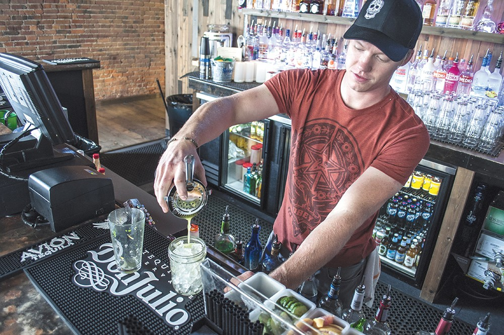 Borracho's Garrett Wellsandt pours a fire roasted margarita. - SARAH WURTZ