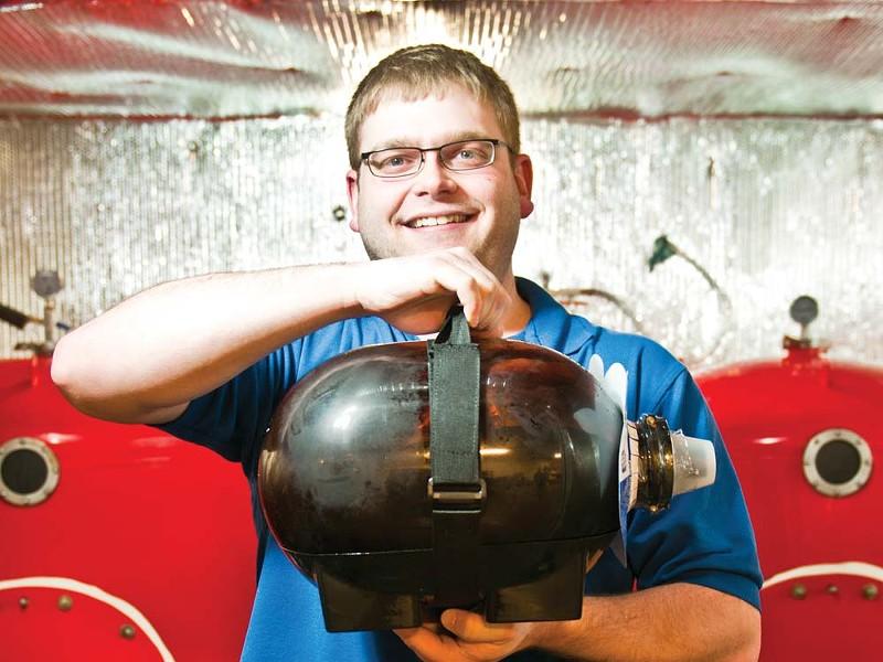 Brad Budge holding an IPA pig - AMY HUNTER