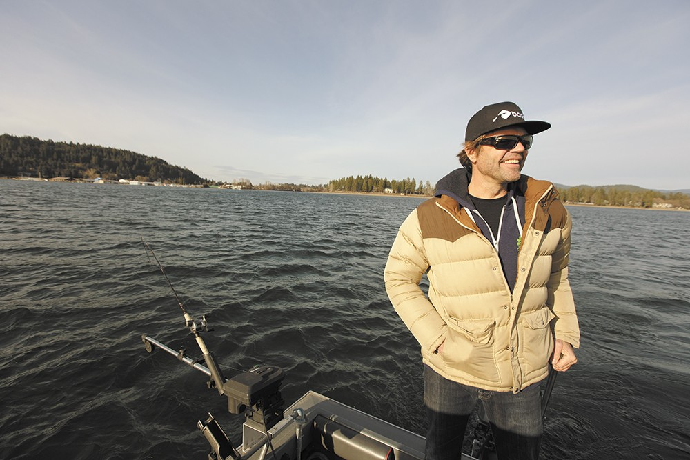 Brad Fosseen fishes area waterways year-round. His gear includes a 22-foot North River fishing boat, fake squid lure and rod with Shimano reel. - YOUNG KWAK