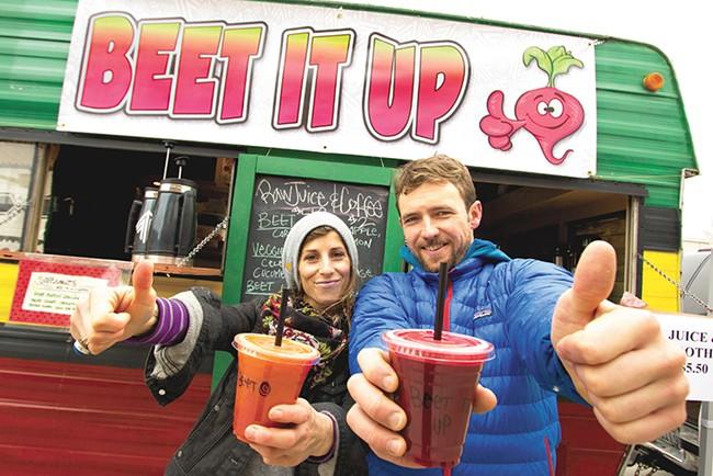 Brandi Elder and John Gardner with their newly opened juice truck. - JOE KONEK