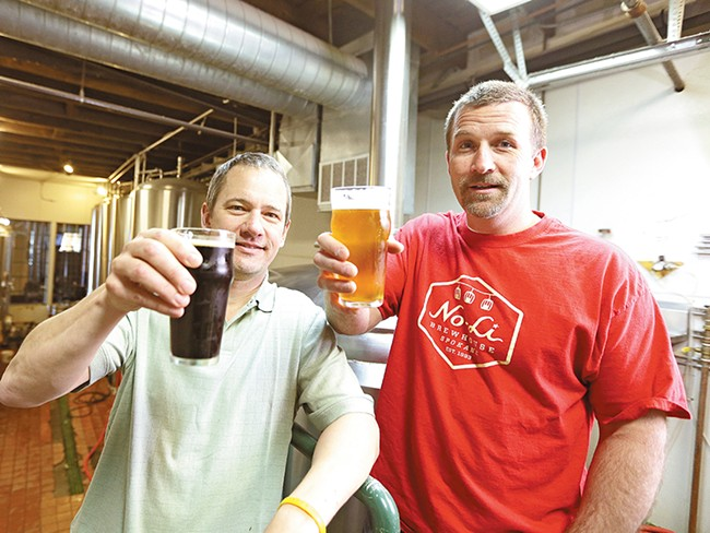 Brewmaster Mark Irvin (left) and partner John Bryant toast their creations inside the No-Li Brewhouse. - YOUNG KWAK