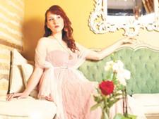 Brigitte Kier models a Mesh Cape ($80)and a Coral Behemian Dress ($80) - YOUNG KWAK