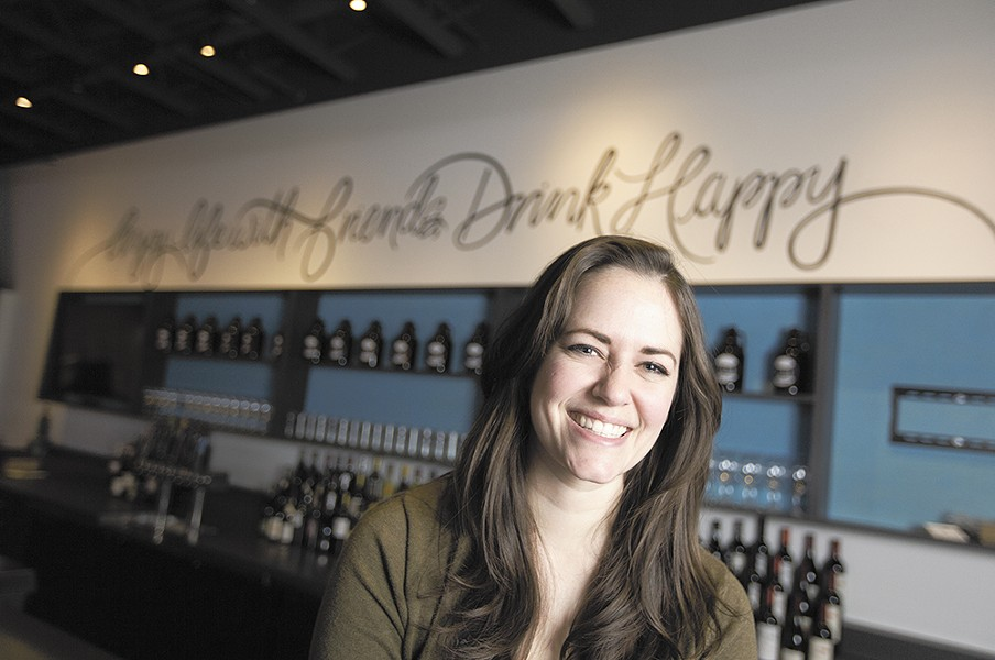 Brittany Stodgell in front of her mural at - Nectar Wine and Beer in Kendall Yards. - YOUNG KWAK
