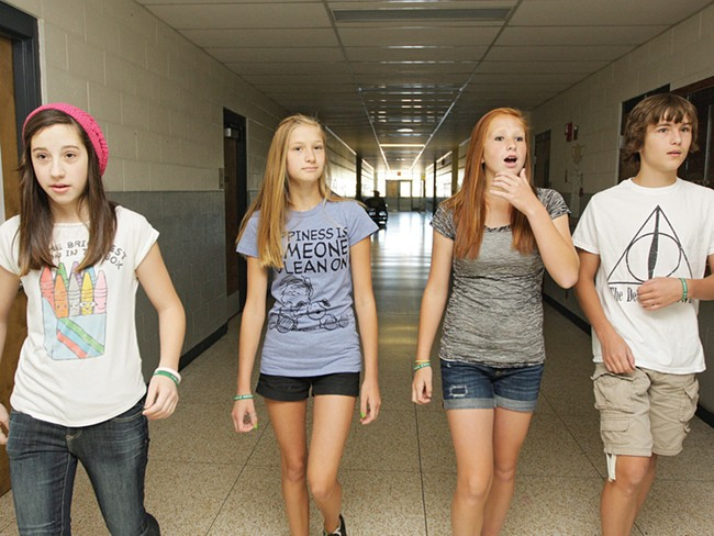 Brooklynn Juris (second from left) walking with her friends. She'll soon have a much longer walk to school. - YOUNG KWAK