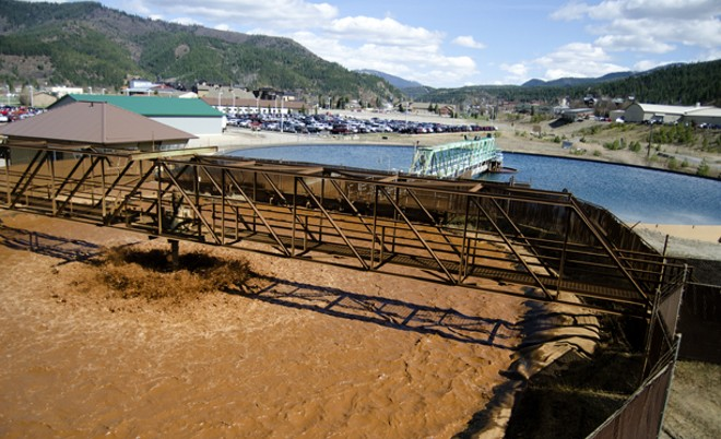 Brown mine drainage is treated with lime to settle metal out of the water. - JACOB JONES