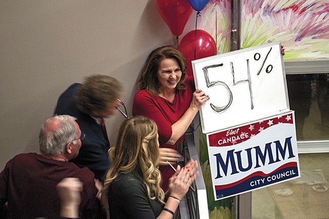Candance Mumm, backed by Council President Ben Stuckart, celebrates Tuesday night. - SARAH WURTZ