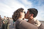 Capt. Ariel Kayne kisses his wife, Sara, for the first time in three months, at Fairchild Air Force Base.