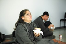 Carrol Ann Harvey-Brock and her husband enjoy soup at the family warming center. - YOUNG KWAK