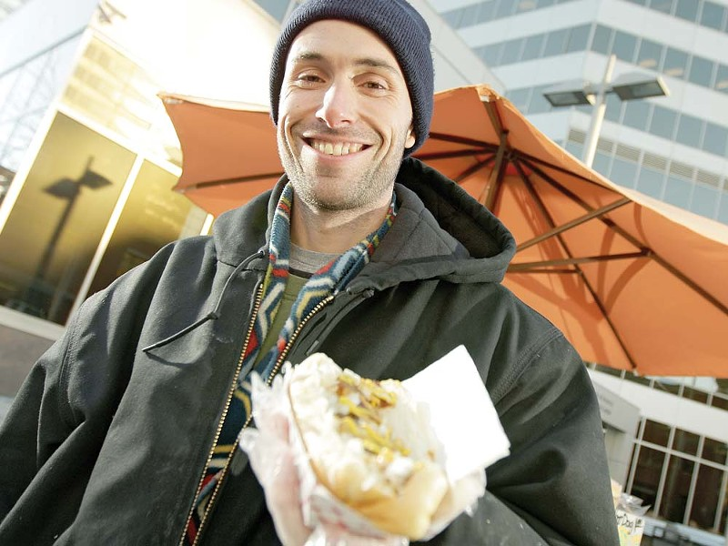 'Cheddar' Chad Rattray with his Polish hot dog - YOUNG KWAK
