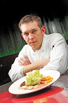 Chef Adam Hegsted (pictured with his Harvest Salad) has added heart-healthy options. - YOUNG KWAK