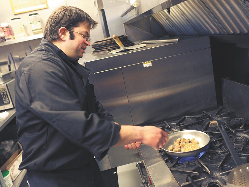 Chef Telly Karatzas prepares a dish at Cafe Italiano\'s new location on the South Hill