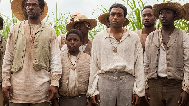 Chiwetel Ejiofor, second from right in the front row, in full Oscar mode.