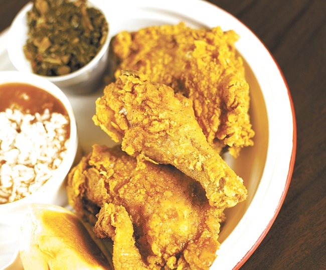 Chkn-N-Mo's fried chicken with red beans and collard greens. - YOUNG KWAK