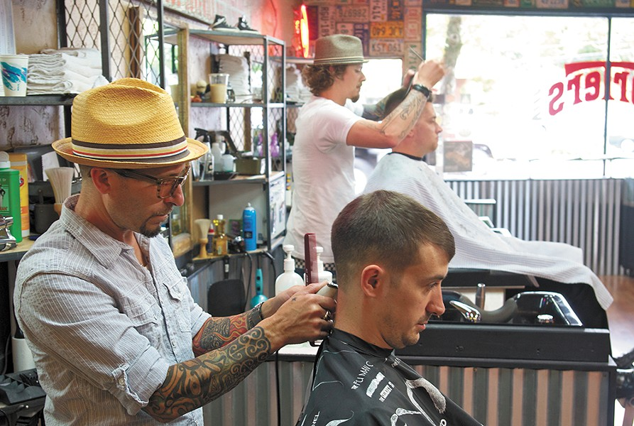 Chris Banks, left, cuts Ryan Brown's hair at Porter's in the Garland District. - SAMUEL SARGEANT
