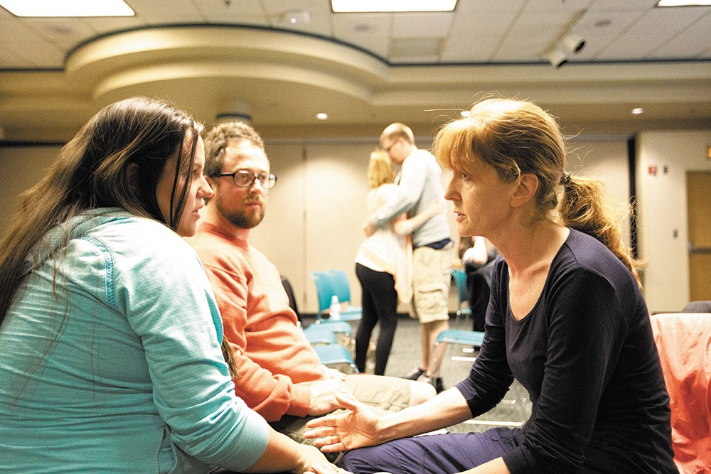 Clair Bennett counsels Amy Evans and Brian Rickey during a Childbirth Education Class. - YOUNG KWAK