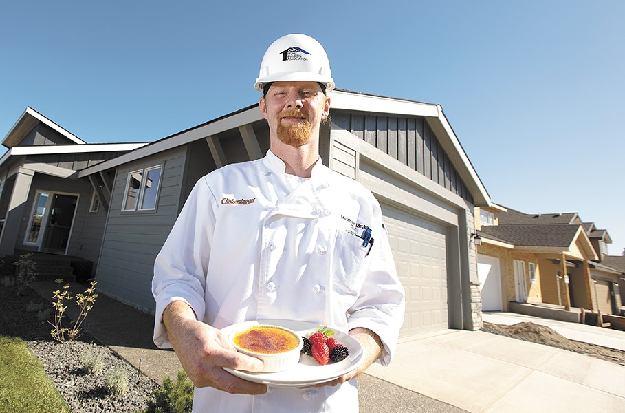 Clinkerdagger Executive Chef Matthew Dircks with a burnt cream dessert at a newly constructed home in the Eagle Ridge neighborhood. - YOUNG KWAK