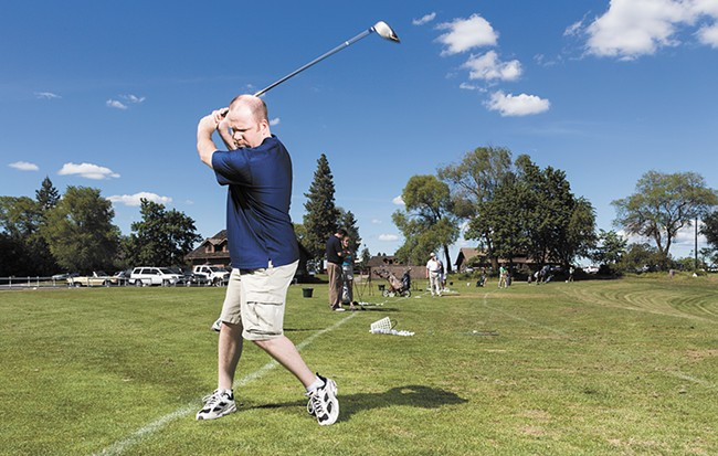 Clint Preston practicing on the driving range at Indian Canyon Golf Course, which is getting a facelift this spring. - STEVEN SCHLANGE