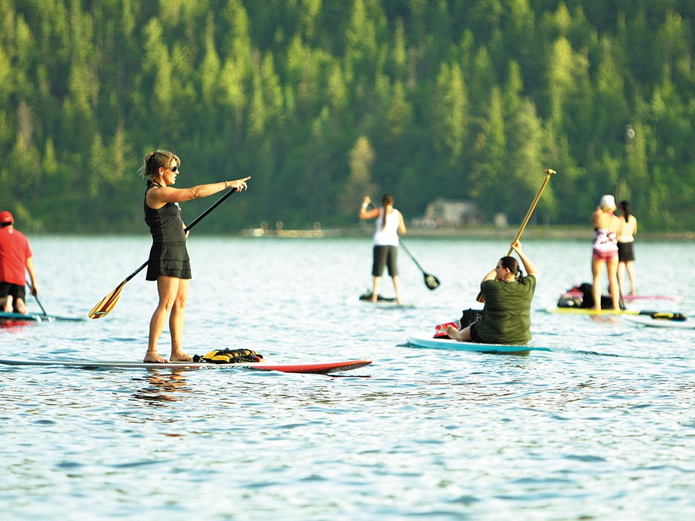 Coeur d\'Alene Paddle Board Co. owner Kym Murdoch, left, leads a class. - YOUNG KWAK