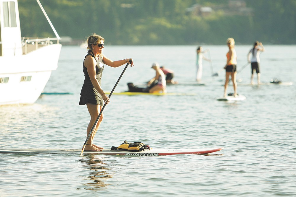 Coeur d'Alene Paddle Board Company owner Kim Murdoch paddles on Coeur d'Alene Lake. - YOUNG KWAK