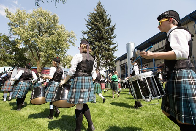 Columbia Regional Pipe Band member Chris Nickerson, right, performs during the opening ceremonies. - YOUNG KWAK