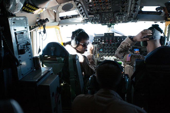(Left to right) Aircraft Commander and Captain Ariel Kayne, Senior Airman and Boom Operator Senior Airman Michael Weidman, and First Lieutenant and Co-Pilot Kevin Bishop fly part of the leg of a trip in a KC-135 from the Transit Center at Manas, Kyrgyzstan, to RAF Mildenhall, England, on Monday. - YOUNG KWAK