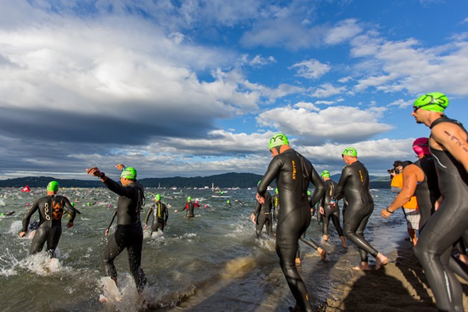 Competitors ran into Coeur d'Alene Lake to begin the 2.4-mile swim, the first portion of the Ironman. - MATT WEIGAND