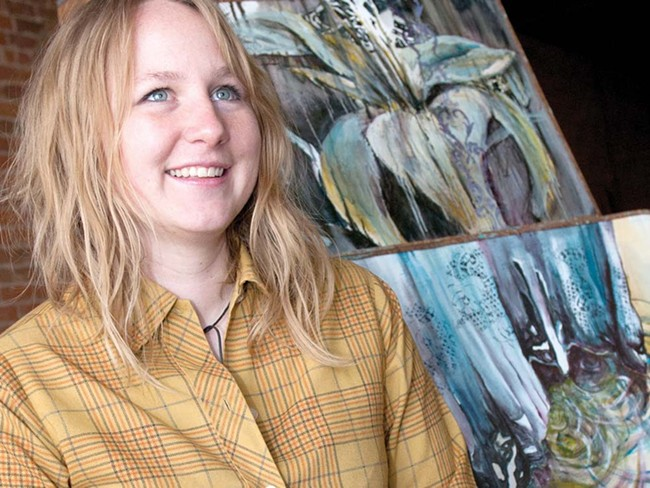 """Cori McWilliams, with three paintings from """"Lilly and the Dress"""" - AMY HUNTER"""